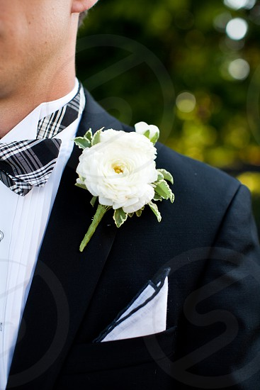 Groom bouttoniere white flower wedding. photo