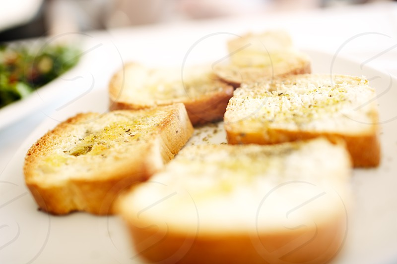 Sliced bread on plate in an outdoor restaurant. Shallow dof. photo