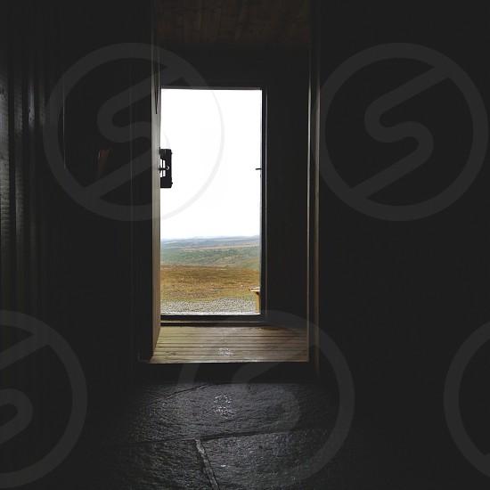 door leading to rolling hills photo