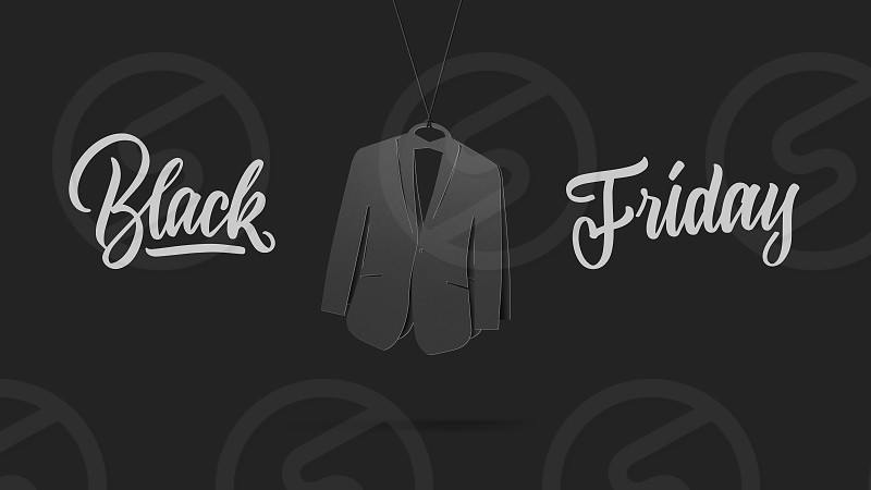 label in shape man's tuxedo on high hill made of cardboard on a gray background.a Calligraphic text black Friday and sales luxury premium style concept photo
