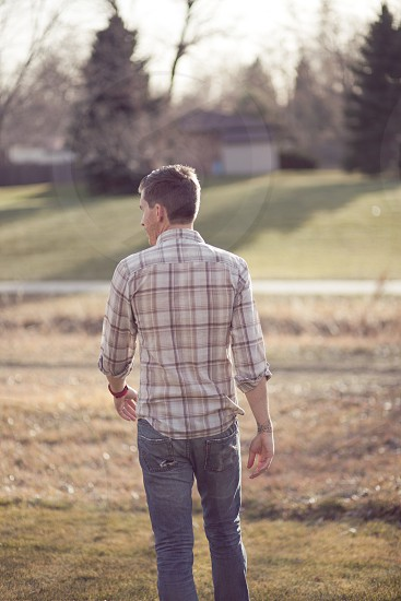 man in white and brown plaid Long Sleeve Button Down Shirt photo