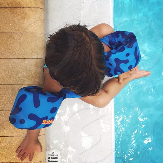 child on pool photo