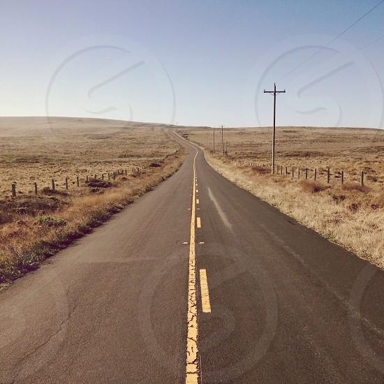 Black asphalt country road photo