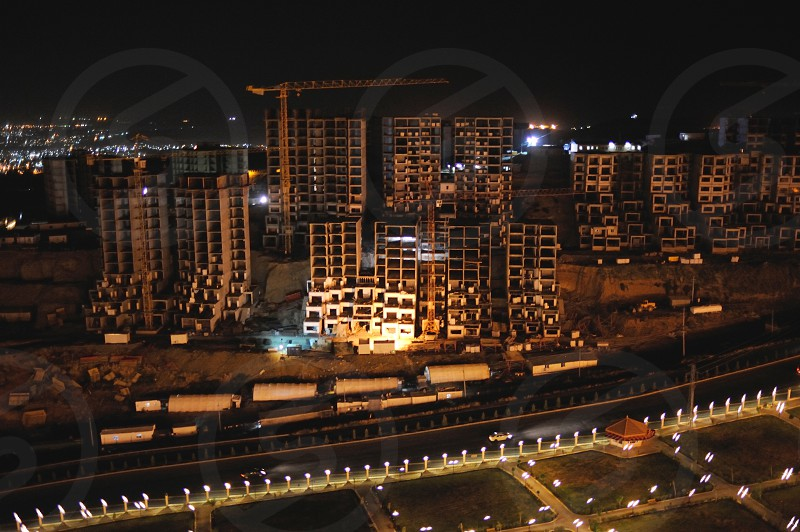 A view at night of a large housing development under construction in Sulaymaniyah in the Kurdish Region of Iraq. photo