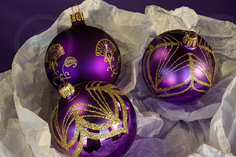 Sparkly purple and gold Christmas season ornaments balls photo