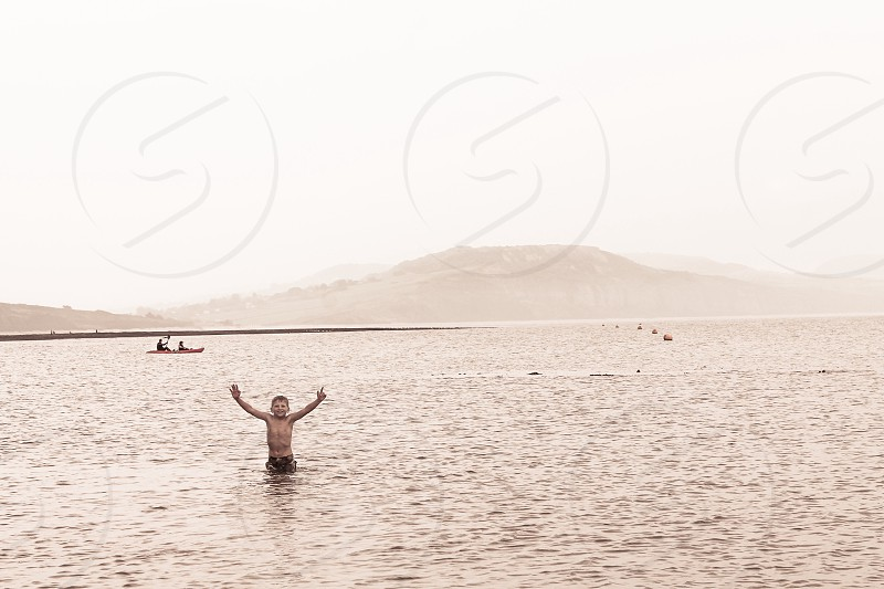 Open armed in cold water photo