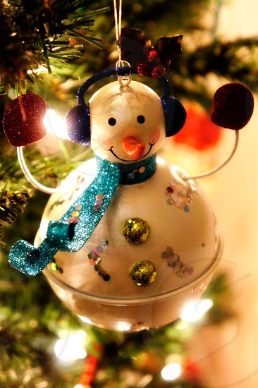 Snowman bell holiday ornament on a Christmas tree photo