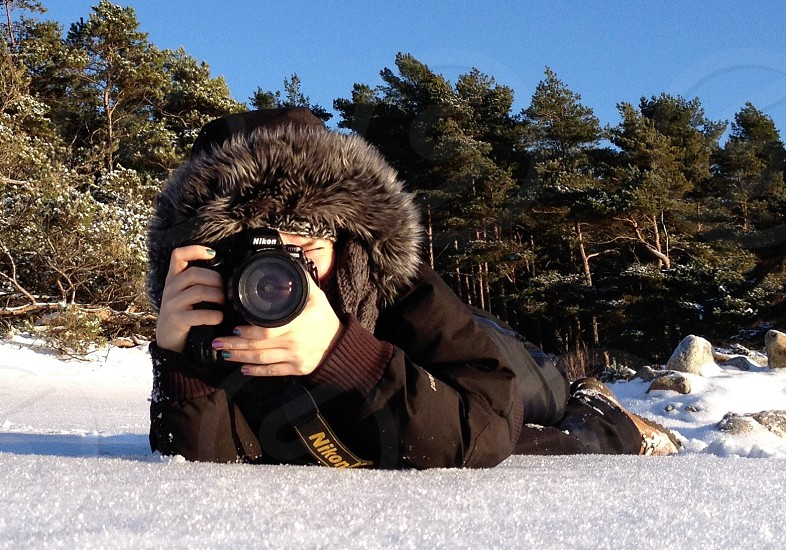 man taking photo on snow photo