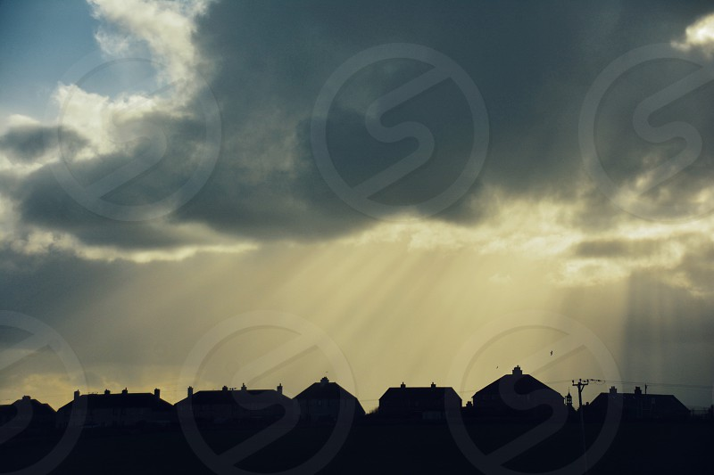 Scotland houses  skyline sky rays photo