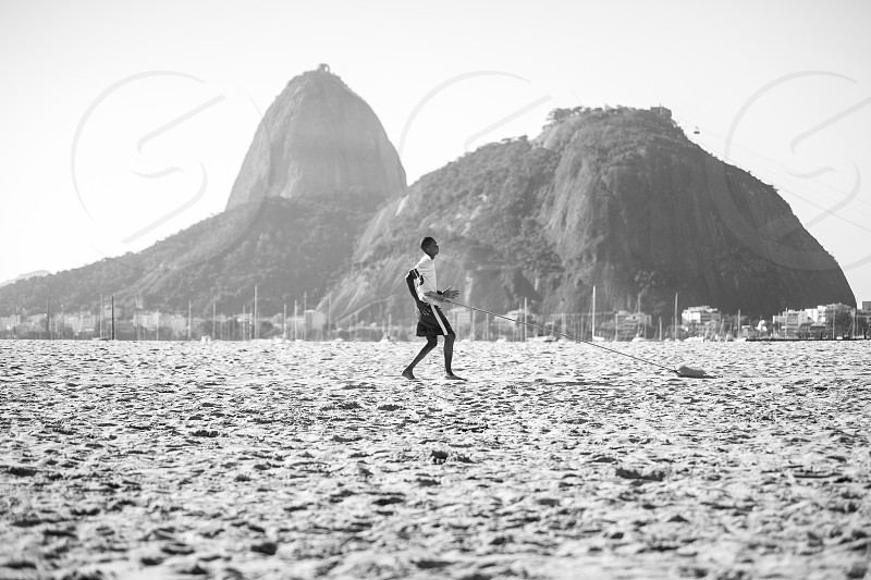 Soccer player training at the beach photo