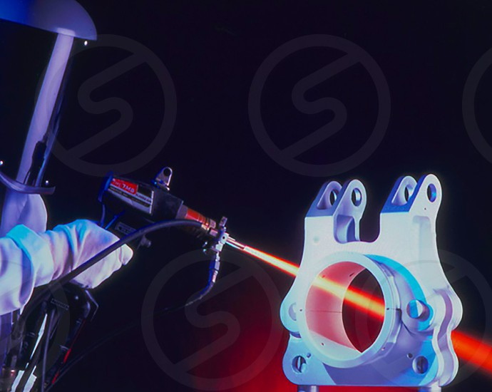 Plasma spraying a high tech part for strenght. photo