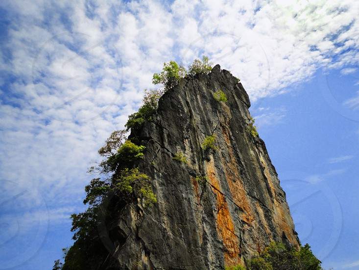 tall mountain low angle view photo