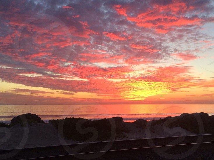 Ocean subset by train tracks photo