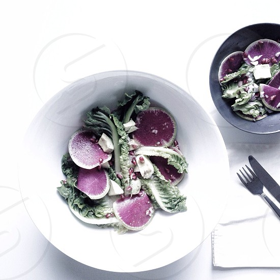 Seasonal salad featuring Watermelon Radish Romaine Pomegranate Avocado with a Lemon Vinaigrette.  photo
