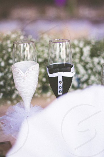 Bride's and groom's champagne glasses photo