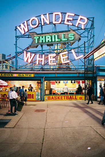 wonder thrills wheel carnival sign board photo