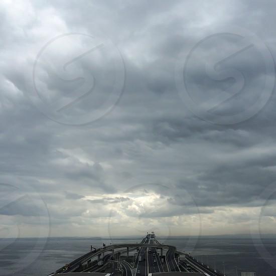 gray concrete bridge over gloomy weather photo