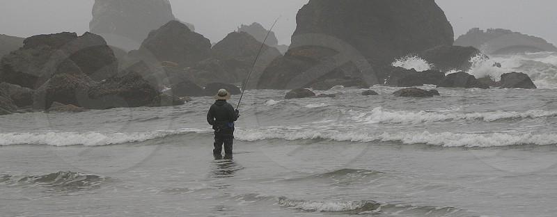 Fisherman. Washington. West coast. Beach. Surf. Sea stacks. photo