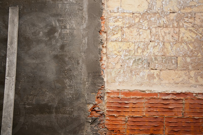 brickwall construction and mortar cement plaster with rulers photo