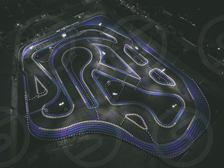 Aerial view from above from a drone of a go kart race track by night photo