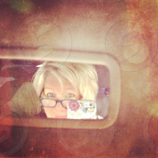person with blonde hair wearing black framed eyeglasses photo
