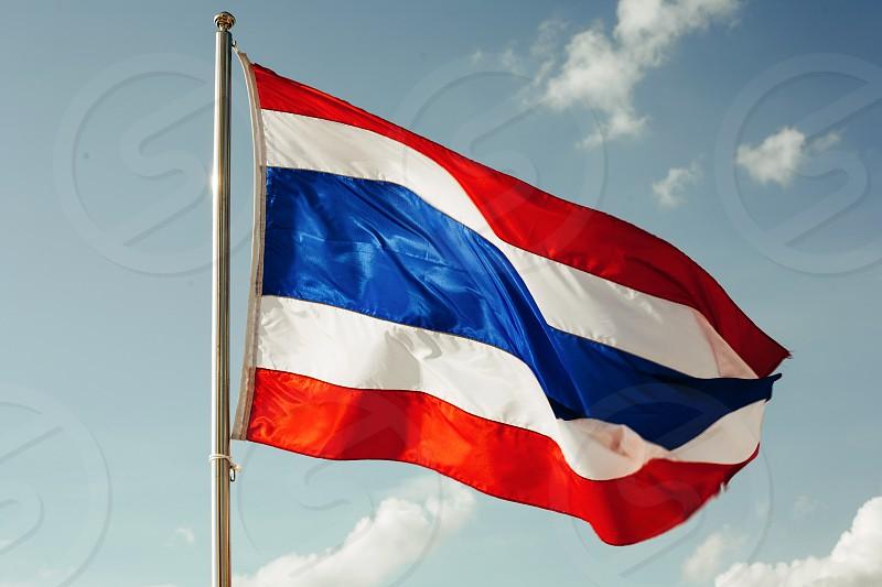 Thai national flag on sky background on a sunny day photo