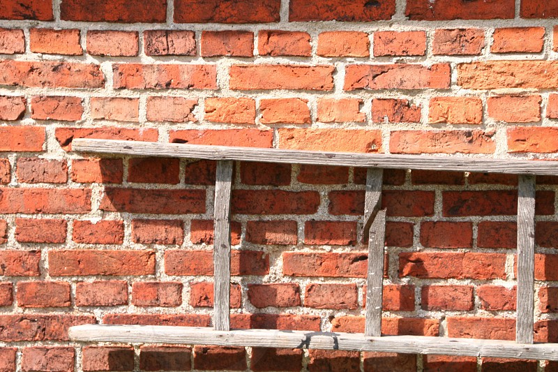 Brick wall wooden ladder photo