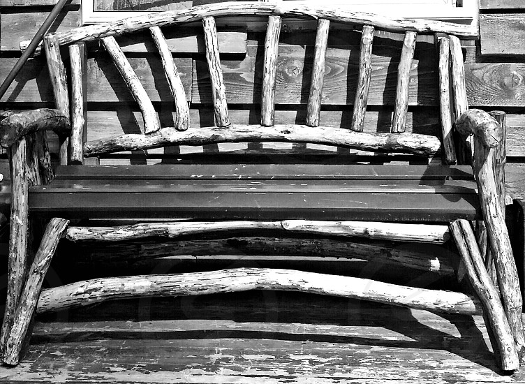 Bench outside of a cabin interior Alaska. photo