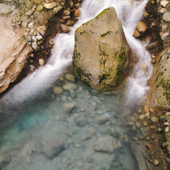 stone in water photo