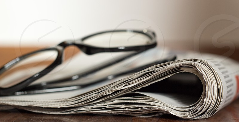 Financial newspaper and eyeglasses photo