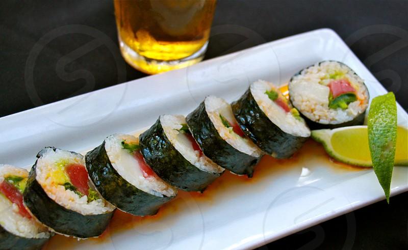 sushi rolls in white ceramic rectangular plate photo