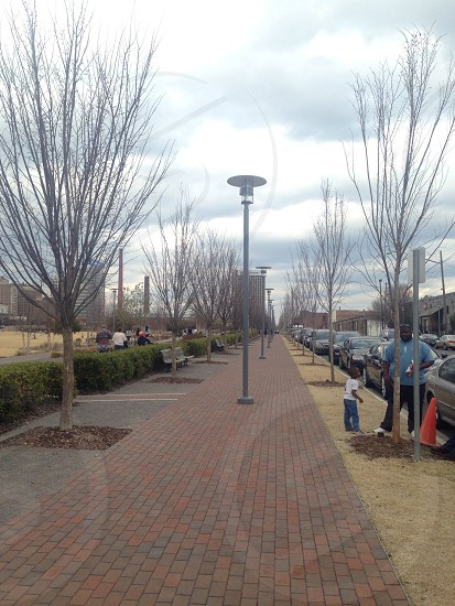 red brick road with street lamps photo
