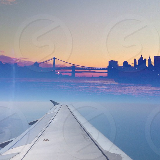 plane wing facing the bridge photo photo