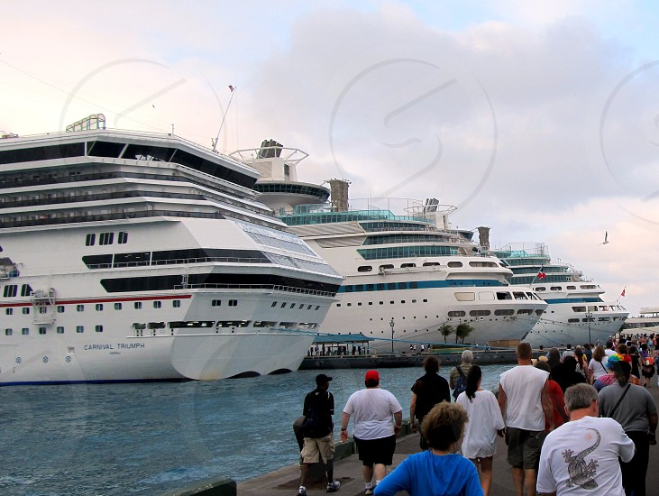 Passengers heading to several cruise ships photo