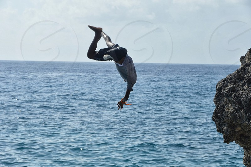 Brave youngster diving from cliffs in Negril. photo