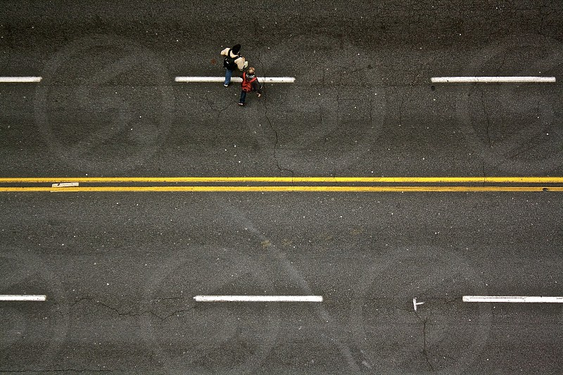 Pedestrians crossing the street during a lull in traffic in Atlanta Georgia. photo