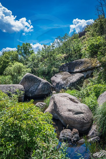 Granite Arbuzinka Rocks in the canyon near the Aktovo village on the Mertvovod river in Ukraine. One of natural wonders of Europe. photo