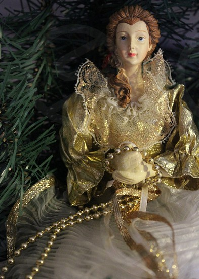 doll wearing gold toned gown photo