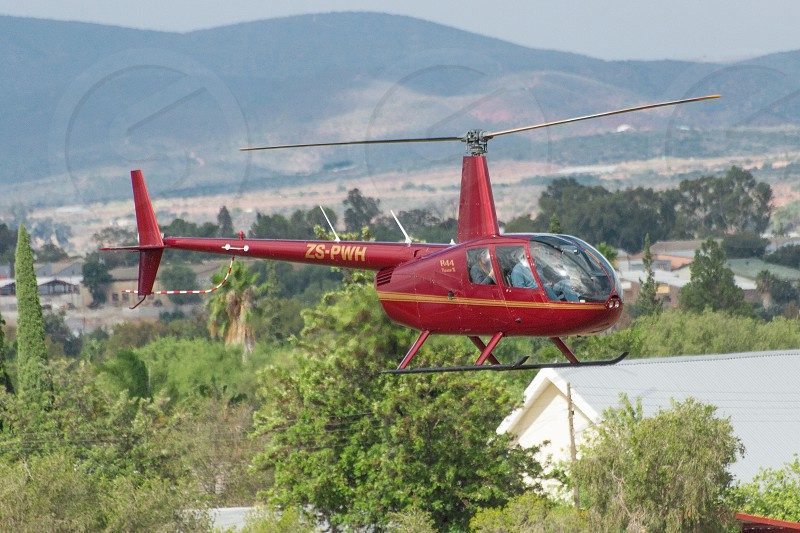 Robinson r44 helicopters aviation helicopter flying flyby scenery africa pilot commercial people photo