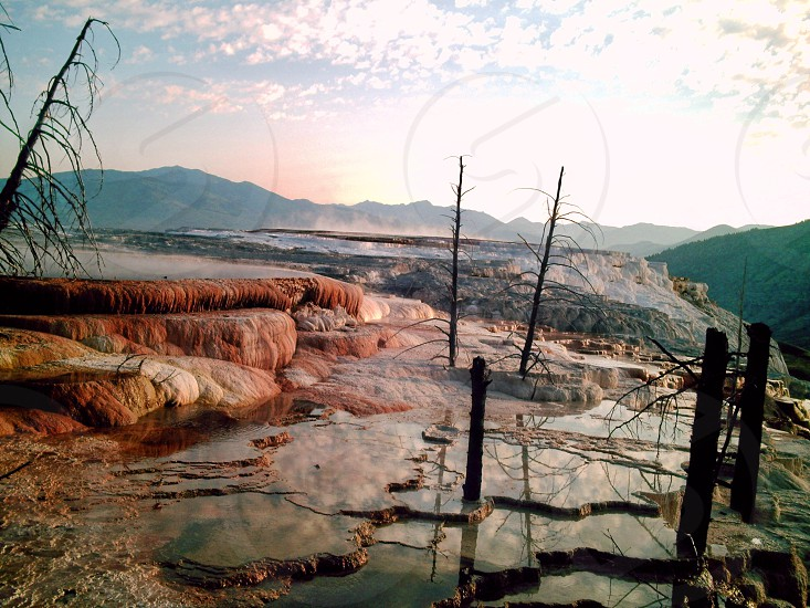 This is a landscape picture of a morning looking at Mammoth Hot Springs in Yellowstone National Park.  photo