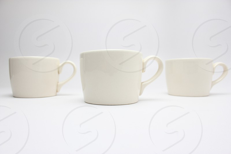 white ceramic mugs  photo