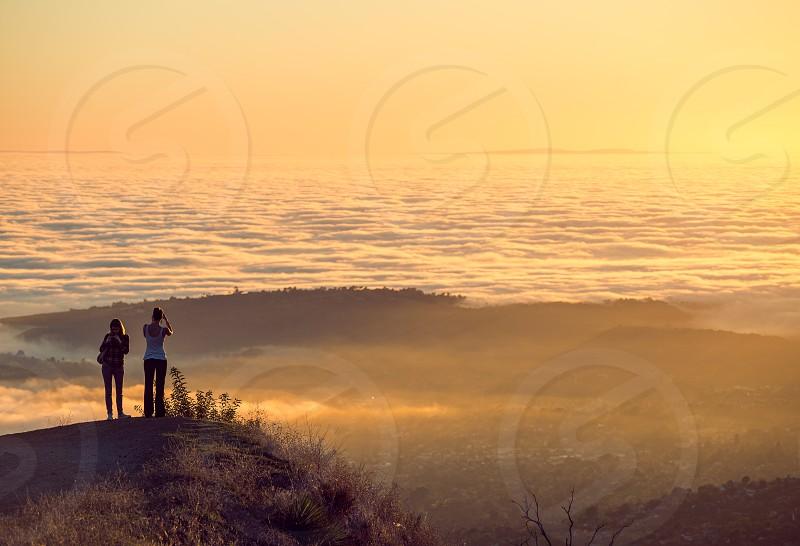 women travel light sunset clouds fog wanderlust photo