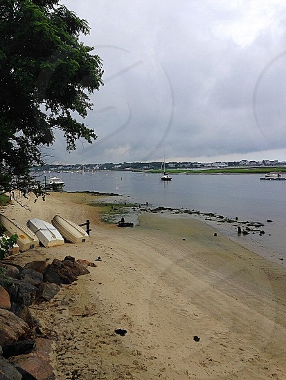 Looking down the Bass River South Yarmouth Cape Cod Massachusetts. River boats sand beach water quiet no people  photo