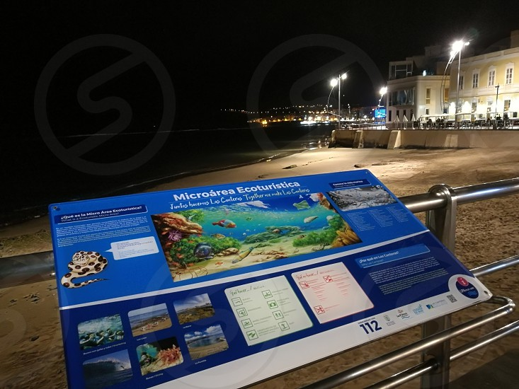 Las Palmas beach landscape with tourist indications at night photo