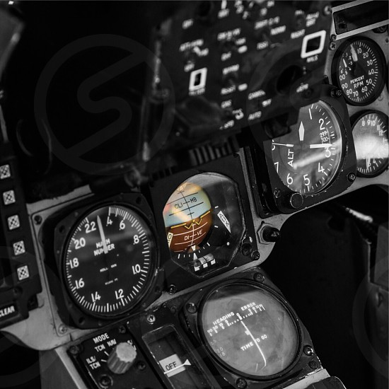 Attitude. Success. Jet cockpit and instrument panel highlighting attitude indicator.  Square format. Available full color and larger format.  photo