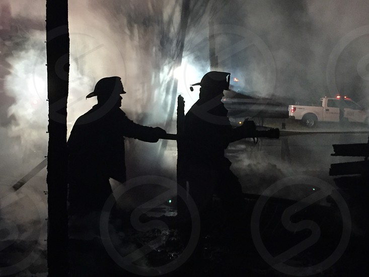 Firefighters on the job.  Smoke.  Fire photo