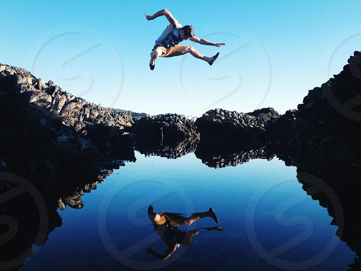 view of man jumping onto late photo
