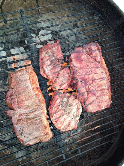 Fire grilled steaks photo