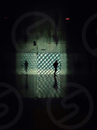silhouette of person at hallway photo