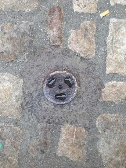 Random face in the ground. photo